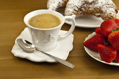 Breakfast with coffee , fresh croissants and strawberries. Royalty Free Stock Photography