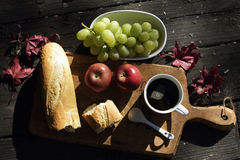 Breakfast with coffee. Grapes and apples, outdoors Stock Photography