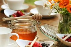Breakfast- coffee, honey, berries Stock Image