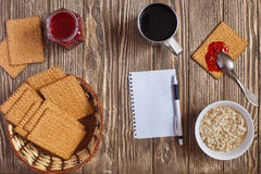 Breakfast with coffee,jam,biscuit,. Oatmeal on wooden background Royalty Free Stock Photo