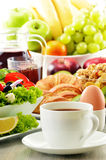 Breakfast with coffee, juice, croissant, salad, muesli and egg Royalty Free Stock Photo