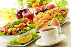 Breakfast with coffee, juice, croissant, salad, muesli and egg Stock Photo