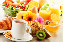 Breakfast with coffee, juice, croissant, salad, muesli and egg Stock Image