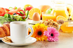 Breakfast with coffee, juice, croissant, salad, muesli and egg Royalty Free Stock Photography