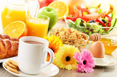 Breakfast with coffee, juice, croissant, salad, muesli and egg Royalty Free Stock Image