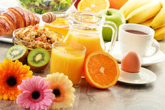 Breakfast with coffee, juice, croissant, salad, muesli and egg Royalty Free Stock Images