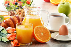 Breakfast with coffee, juice, croissant, salad, muesli and egg Stock Photography