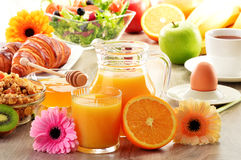 Breakfast with coffee, juice, croissant, salad, muesli and egg Royalty Free Stock Photos