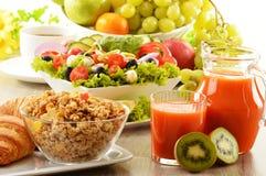 Breakfast with coffee, juice, croissant, salad, muesli and egg Stock Photos