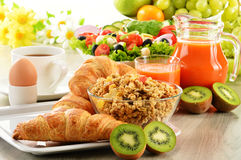 Breakfast with coffee, juice, croissant, salad, muesli and egg Stock Photos
