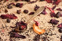 Red tea (karkade) on the table with a spoon Royalty Free Stock Image