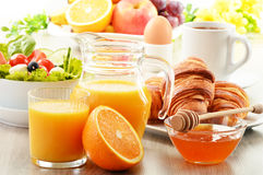 Breakfast with coffee, orange juice, croissant, egg, vegetables Stock Photography