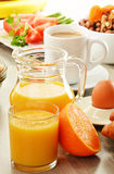 Breakfast with coffee, orange juice, croissant, egg, vegetables Stock Images