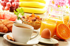 Breakfast with coffee, orange juice, croissant, egg, vegetables Royalty Free Stock Images