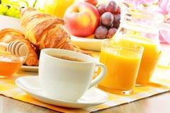 Breakfast with coffee, orange juice, croissant, egg, vegetables Stock Images