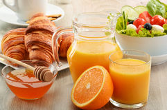 Breakfast with coffee, orange juice, croissant, vegetables Royalty Free Stock Images