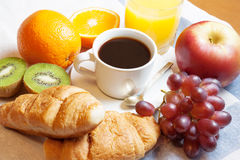 Breakfast with coffee, orange juice, croissants  and fruits Stock Photography