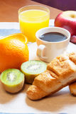 Breakfast with coffee, orange juice, croissants  and fruits Royalty Free Stock Image