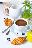 Breakfast, coffee, pastries and fruits Royalty Free Stock Photography