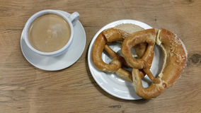 Breakfast with coffee and pretzels Royalty Free Stock Photography