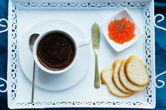 Breakfast of coffee and red caviar stock photography