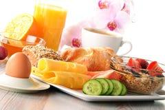 Breakfast with coffee, rolls, egg, orange juice Royalty Free Stock Image