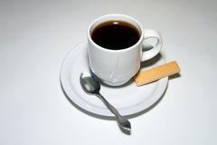 Breakfast Coffee and a Sugar Wafer Royalty Free Stock Photos