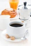 Breakfast with coffee, sweet bun, fresh cream and orange juice Royalty Free Stock Photography