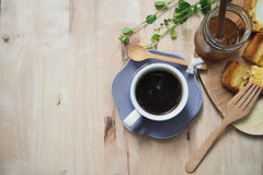 Breakfast coffee time. Black coffee with toast and egg on wood table stock photography