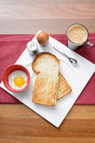 Breakfast with coffee, toast bread and half-boiled egg Royalty Free Stock Images