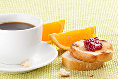 Breakfast with coffee, toast ,cherry jam and orange Royalty Free Stock Image