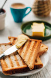 Breakfast with coffee, toasts, butter and jam Royalty Free Stock Images
