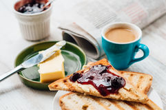 Breakfast with coffee, toasts, butter and jam Royalty Free Stock Photo