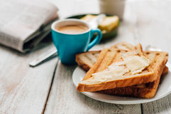 Breakfast with coffee, toasts, butter and jam Royalty Free Stock Image