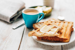 Breakfast with coffee, toasts, butter and jam Stock Image