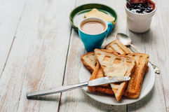 Breakfast with coffee, toasts, butter and jam Stock Photos
