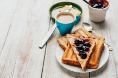 Breakfast with coffee, toasts, butter and jam Stock Photography