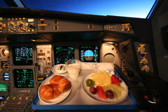 Breakfast in the cokpit. Of an airliner, first officer view Stock Photos