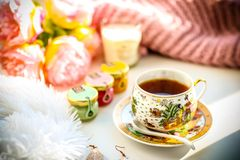 Breakfast composition. Cup of tea jams flowers and candle royalty free stock images