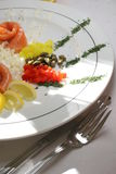 Breakfast composition with salmon. Lemon, spice in exclusive version on the plate Stock Images
