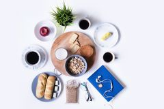 Assorted food and coffee with notebook on the table. stock image