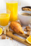 Breakfast concept - coffee, croissant and orange juice on a whit Stock Images