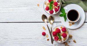 Breakfast concept. Coffee muesli granola berries homemade yogurt Stock Photo