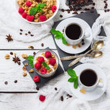 Breakfast concept. Coffee muesli granola berries homemade yogurt royalty free stock photography