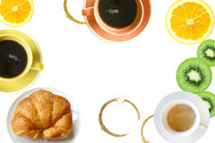 Breakfast concept. Coffee and oranges and fresh baked tasty croissant on white background Stock Photography
