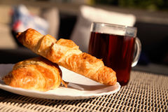 Breakfast concept - croissant and tea Stock Image