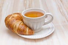 Breakfast concept croissant and tea Stock Photos