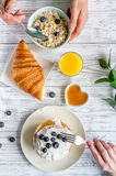Breakfast concept with flowers on wooden background top view Stock Photo