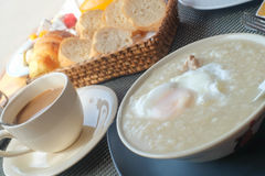 Congee with egg and coffee Royalty Free Stock Image
