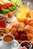 Breakfast consisting of croissants, coffee, fruits, orange juice Royalty Free Stock Photos